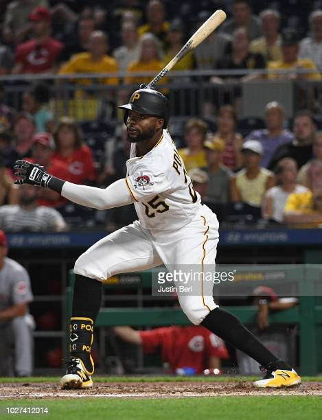 Gregory Polanco of the Pittsburgh Pirates hits an RBI single to left field in the third inning during the game against the Cincinnati Reds at PNC...