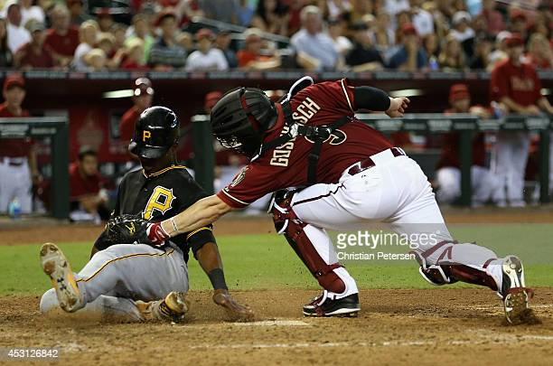 Gregory Polanco of the Pittsburgh Pirates is tagged out sliding into home plate by catcher Tuffy Gosewisch of the Arizona Diamondbacks during the...