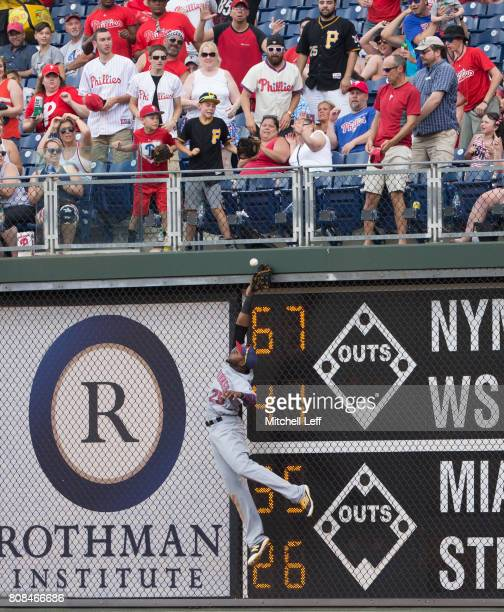 Gregory Polanco of the Pittsburgh Pirates leaps for the ball but cannot make the catch on a triple hit by Aaron Altherr of the Philadelphia Phillies...