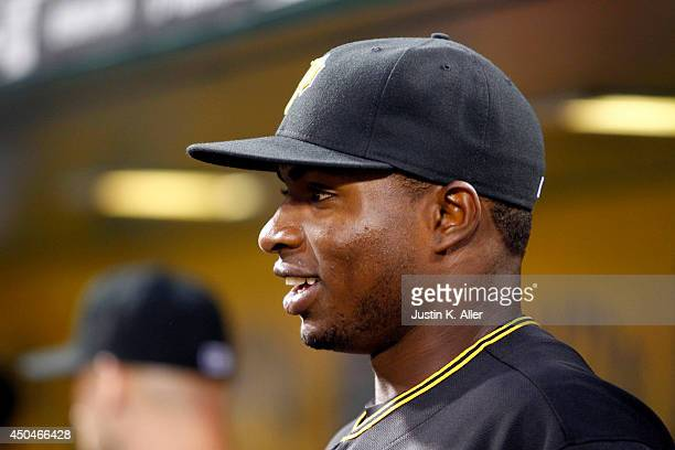 Gregory Polanco of the Pittsburgh Pirates looks on from the dugout against the Chicago Cubs during the game at PNC Park on June 11 2014 in Pittsburgh...