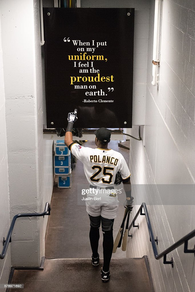 Gregory Polanco #25 of the Pittsburgh Pirates points to a sign honoring Roberto Clemente as he heads towards the dugout before the game against the Philadelphia Phillies at PNC Park on July 22, 2016 in Pittsburgh, Pennsylvania.