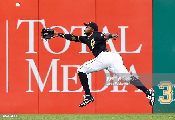 Gregory Polanco of the Pittsburgh Pirates reaches for a fly ball in right field but comes up short in the second inning against the Arizona...