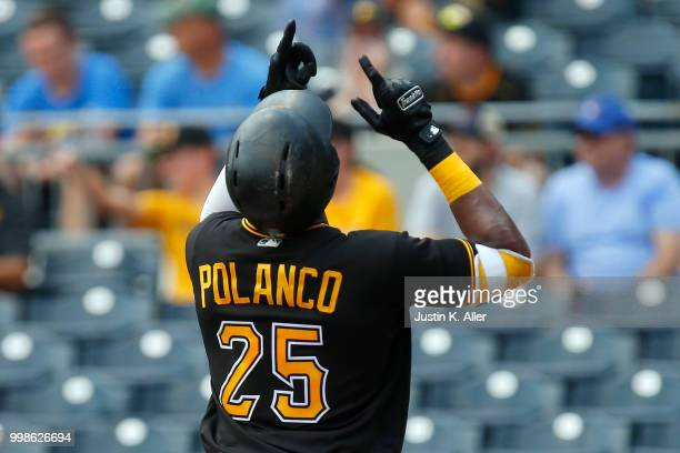 Gregory Polanco of the Pittsburgh Pirates reacts after hitting a home run in the first inning during game one of a doubleheader against the Milwaukee...