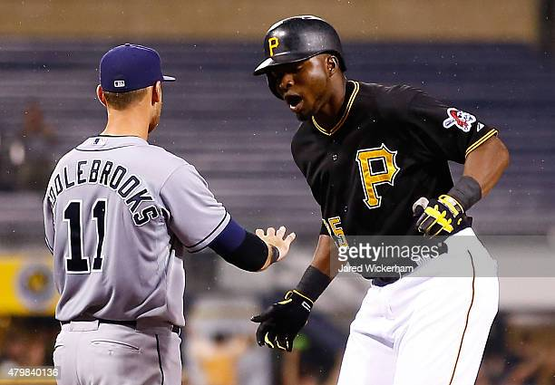 Gregory Polanco of the Pittsburgh Pirates reacts following his goahead RBI triple in the eighth inning against the San Diego Padres during the game...
