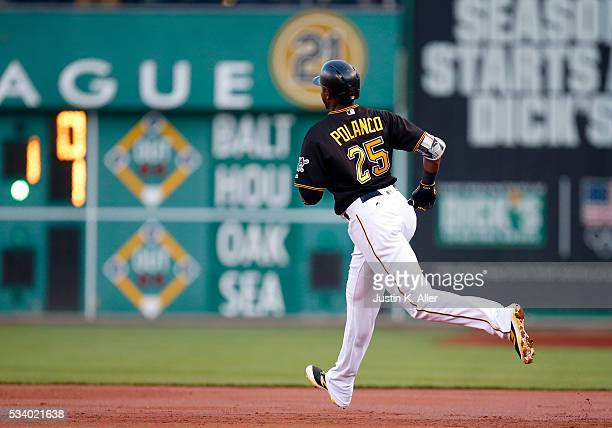 Gregory Polanco of the Pittsburgh Pirates rounds first base after hitting a threerun home run in the first inning during the game against the Arizona...