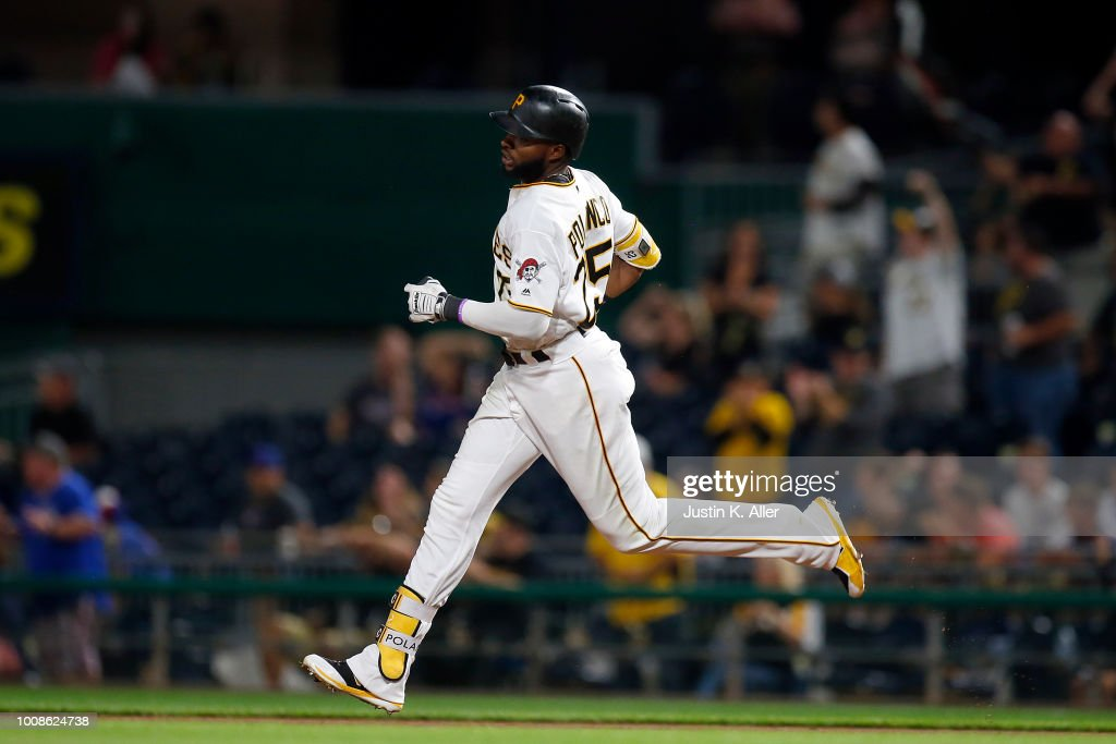 Gregory Polanco #25 of the Pittsburgh Pirates rounds first base on his solo home run in the eighth inning against the Chicago Cubs at PNC Park on July 31, 2018 in Pittsburgh, Pennsylvania.