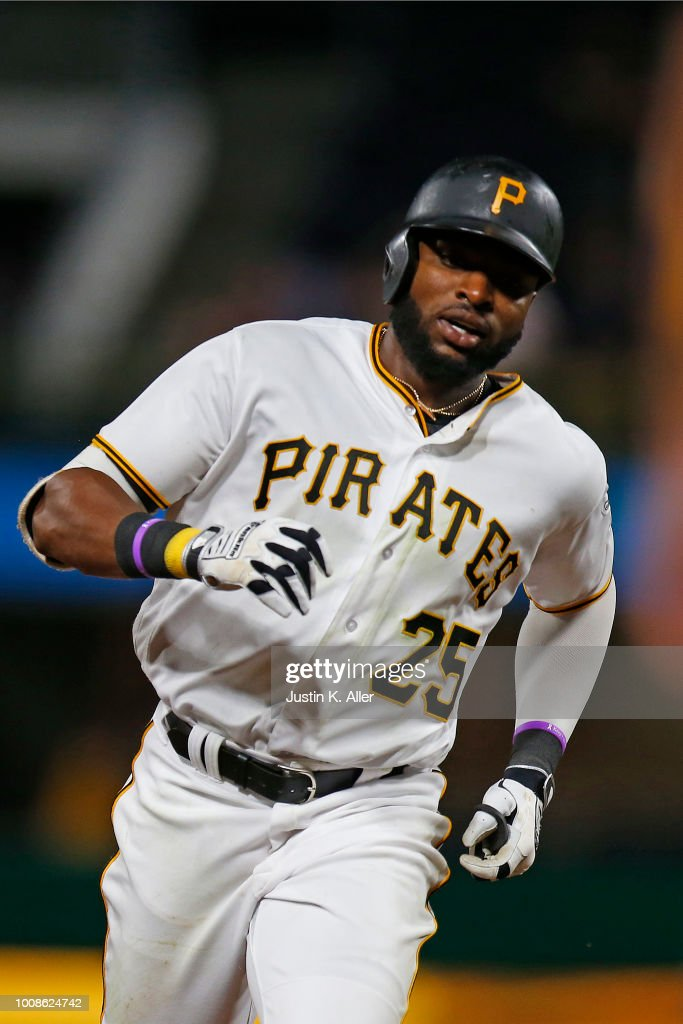 Gregory Polanco #25 of the Pittsburgh Pirates rounds second base on his solo home run in the eighth inning against the Chicago Cubs at PNC Park on July 31, 2018 in Pittsburgh, Pennsylvania.