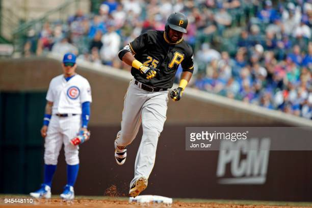 Gregory Polanco of the Pittsburgh Pirates rounds the bases after hitting a home run in the seventh inning against the Chicago Cubs at Wrigley Field...