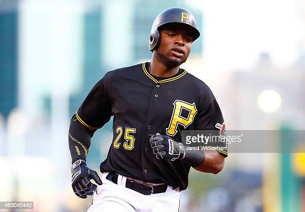 Gregory Polanco of the Pittsburgh Pirates rounds third base after hitting a solo home run in the first inning against the Chicago Cubs during the...