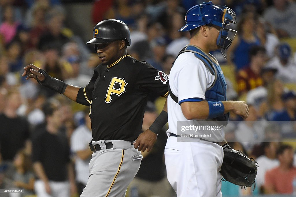 Gregory Polanco #25 of the Pittsburgh Pirates scores in the eighth inning against the Los Angeles Dodgers at Dodger Stadium on September 19, 2015 in Los Angeles, California.