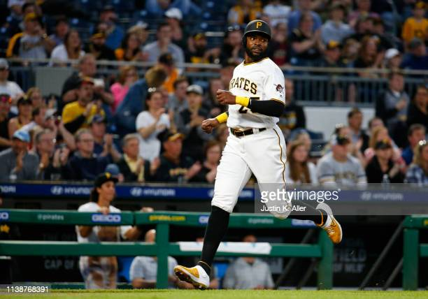 Gregory Polanco of the Pittsburgh Pirates scores on an RBI double in the third inning against the Arizona Diamondbacks at PNC Park on April 22 2019...