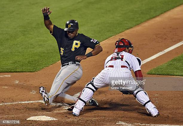 Gregory Polanco of the Pittsburgh Pirates slides past Carlos Ruiz of the Philadelphia Phillies for the eventual gamewinning run in the seventh inning...