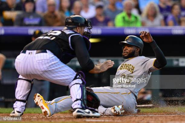 Gregory Polanco of the Pittsburgh Pirates slides to home plate and scores on a fifth inning double and beats a tag attempt by Chris Iannetta of the...