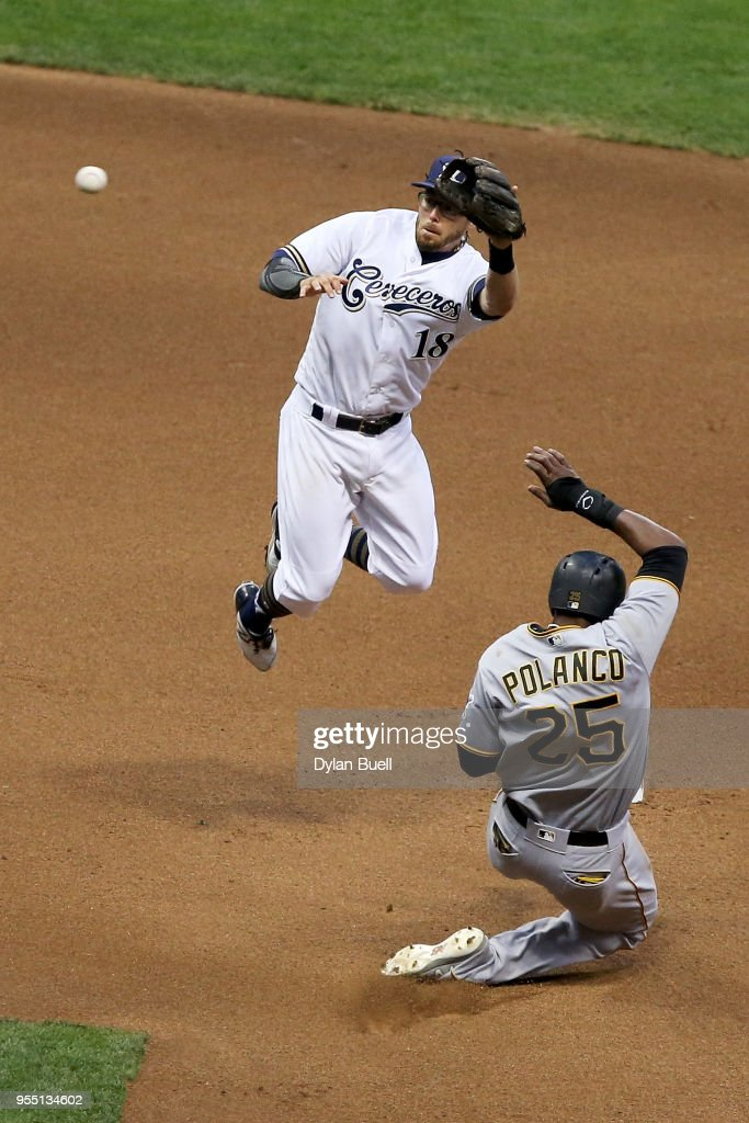 Gregory Polanco #25 of the Pittsburgh Pirates steals second base past Eric Sogard #18 of the Milwaukee Brewers in the sixth inning at Miller Park on May 5, 2018 in Milwaukee, Wisconsin.