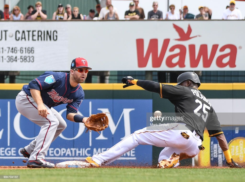 Gregory Polanco #25 of the Pittsburgh Pirates steals second base with Brian Dozier #2 of the Minnesota Twins defending in the first inning during the spring training game between the Pittsburgh Pirates and the Minnesota Twins at LECOM Field on March 19, 2018 in Bradenton, Florida.