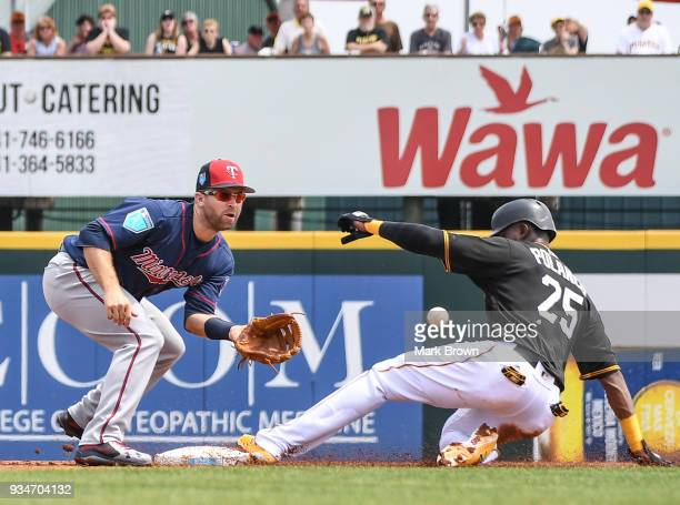 Gregory Polanco of the Pittsburgh Pirates steals second base with Brian Dozier of the Minnesota Twins defending in the first inning during the spring...