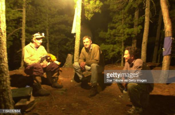 Gregory Powers left of St Paul Terry Arnesen Stillwater and Tony Kennedy Newport gather beneath a gas lantern on a recent night in Quetico Provincial...