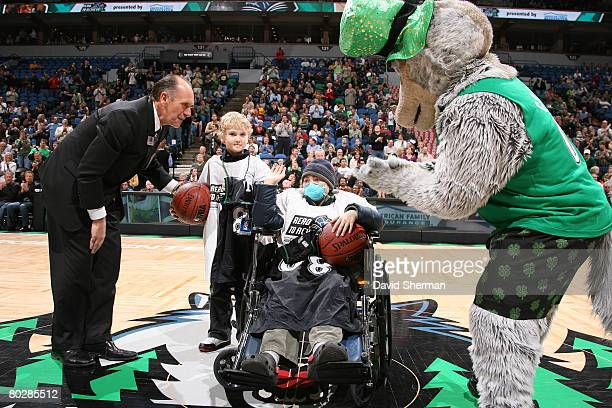 Gregory Ramsey diagnosed with fanconi anemia and his brother Christopher receive Timberwolves jerseys from Team President Chris Wright and mascot...