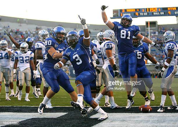 Gregory Ray of the Memphis Tigers celebrates his touchdown with teammates Deven Onarheim and Brooks Johnson against the Middle Tennessee Blue Raiders...