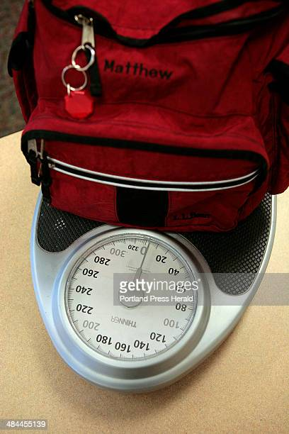 Gregory Rec/Staff Photographer A student's backpack is weighed at Kennebunk Elementary School on Tuesday September 18 2007 during an ergonomics...