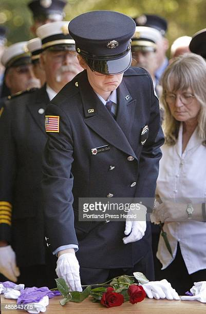 Amanda DeMeule daughter of Debra Cole places a rose on Debra Cole's casket during a graveside ceremony at Pine Grove cemetery in Kennebunk on Tuesday...