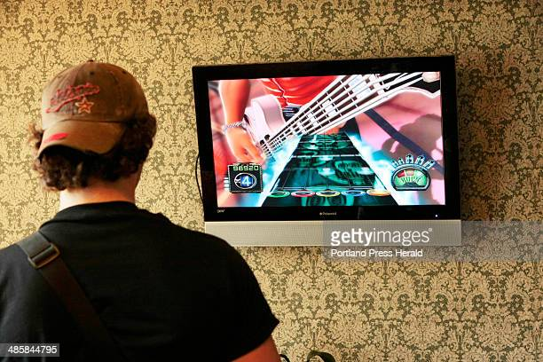 Gregory Rec/Staff Photographer -- Conrad Curry of Texas practices a song on the Guitar Hero game in the lobby of the Howard Johnson's hotel in...
