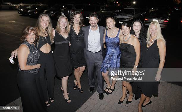 From left Lorri Hall Amy Sturgis Karen Reny Meaghen Kenney Shad Hall Kim Cobb Lida Hutchings Meghann Bagetis and Amy Bedard at the Divatini event at...