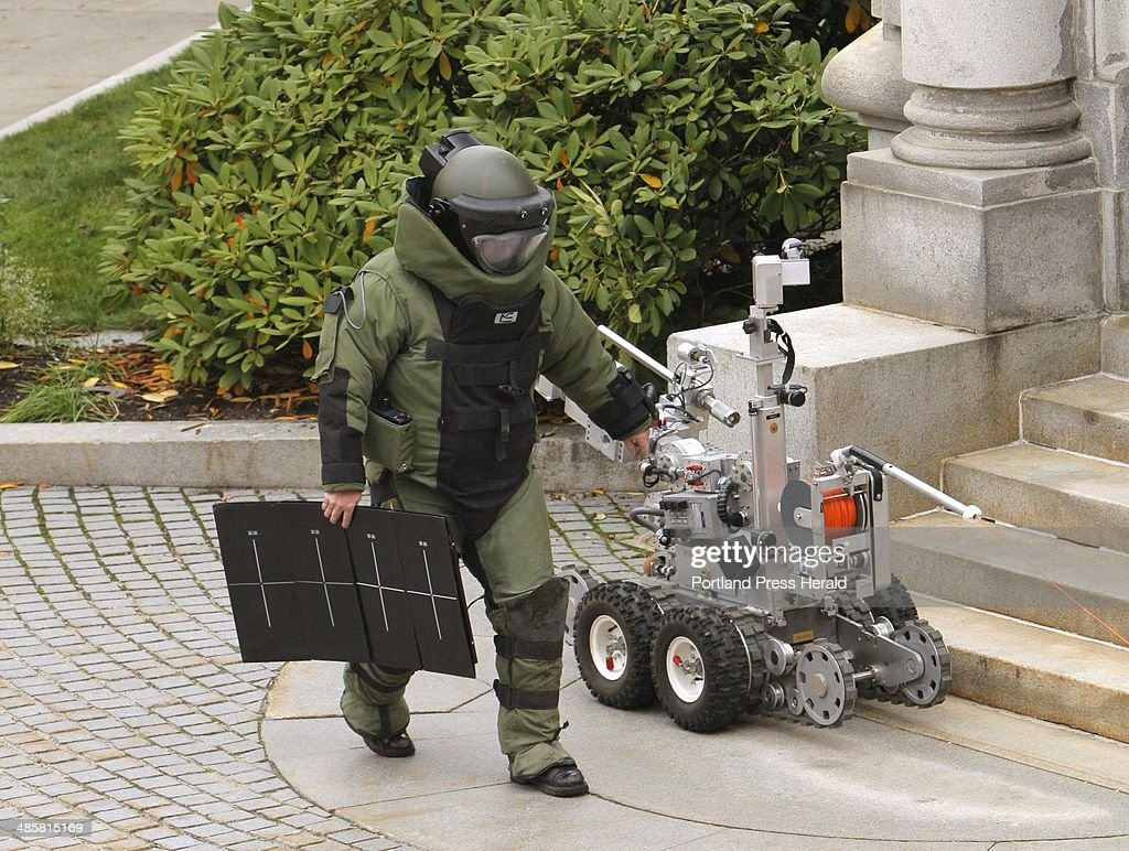 Jay Twomey, a bomb specialist with the Portland Police Department, carries a piece of x-ray equipme : News Photo