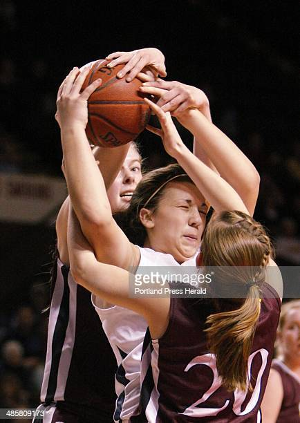 Marquis MacGlashing of York is pressured by Nicole Faietta front and Abigail Young of Greely during the western girls Class B championship final...