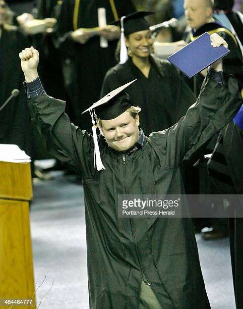 Gregory Rec/Staff Photographer Martin Holmes of Auburn celebrates after receving his diploma during graduation ceremonies for the University of...