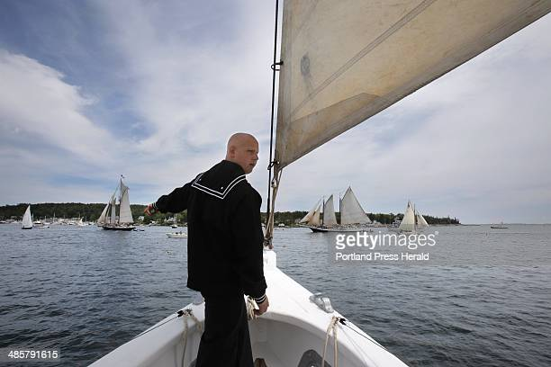 Sea Scout Joseph Holman of Woolwich calls out the location of a mooring buoy while on watch at the bow of the schooner Bowdoin as the schooner sails...