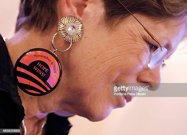 Sydney Roberts Rockefeller of Seal Harbor sports an Obama button as an earring at a reception for Mainers hosted by Rep Mike Michaud and Rep Chellie...