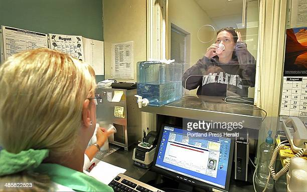 Tasheena Fitzsimmons takes her methadone dose at Discovery House in Calais in August 2 2011