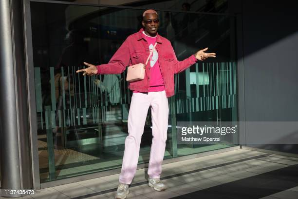 Gregory Robert is seen wearing pink jacket and shirt white pants and sneakers with cream bag and sunglasses during the Amazon Fashion Week TOKYO 2019...