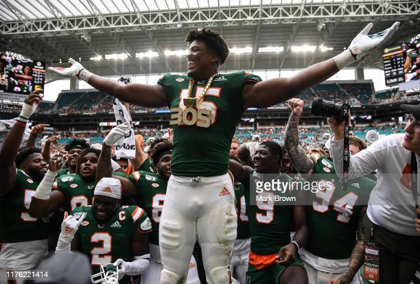 "Gregory Rousseau of the Miami Hurricanes celebrates with the ""Turnover Chain"" after a sack and fumble recovery in the first half against the Central..."