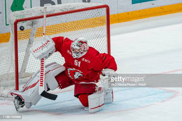 Gregory Sciaroni of SC Bern scores a goal against Goalie Tobias Stephan of Lausanne HC during the Swiss National League game between Lausanne HC and...