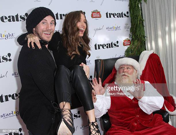 Gregory Siff Alyssa Arce and Santa attend treats Issue 10 Holiday Brunch presented by Stella Artois and Chateau La Coste at Ysabel on December 13...