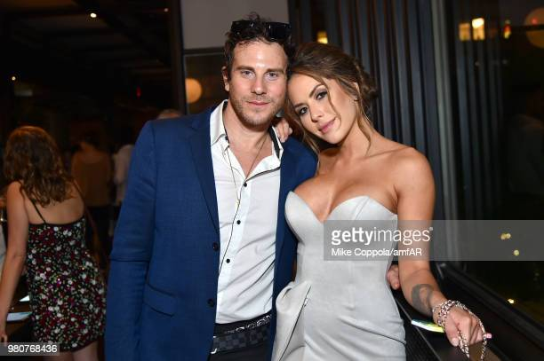 Gregory Siff and Brittney Palmer attend the amfAR GenCure Solstice 2018 on June 21 2018 in New York City
