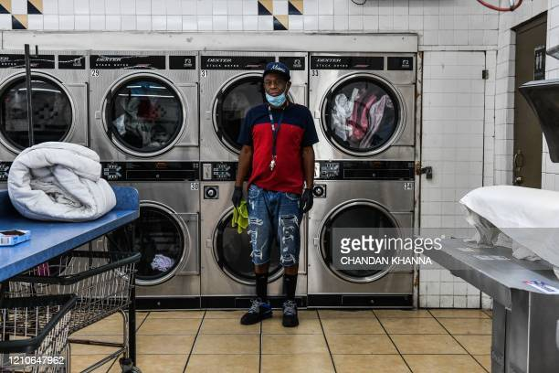 Gregory Stark laundromat cleaning employee poses for a picture in Miami on April 17 2020 Stark works more than 8 hours everyday at a laundry shop in...