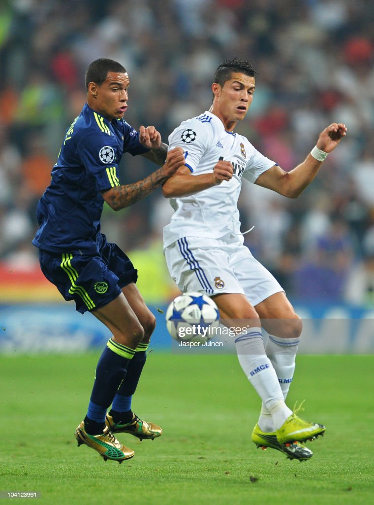 Gregory van der Wiel (L) of Ajax duels for the ball with Cristiano Ronaldo of Real Madrid during the UEFA Champions League group G match between Real Madrid and Ajax at the Estadio Santiago Bernabeu on September 15, 2010 in Madrid, Spain.