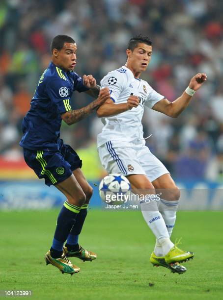 Gregory van der Wiel of Ajax duels for the ball with Cristiano Ronaldo of Real Madrid during the UEFA Champions League group G match between Real...