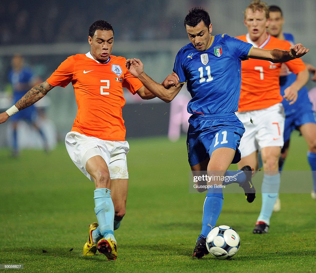 Gregory van der Wiel of Holland and Raffaele Palladino of Italy in action during the International Friendly Match between Italy and Holland at Adriatico Stadium on November 14, 2009 in Pescara, Italy.