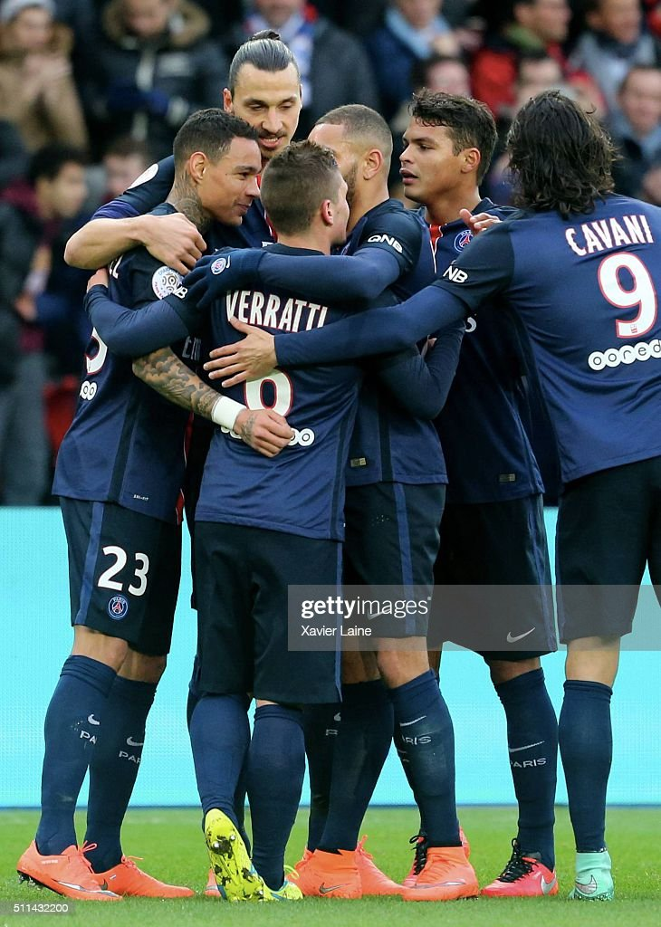 Gregory Van Der Wiel #23 of Paris Saint-Germain celebrate his goal with team-mattes during the French Ligue 1 between Paris Saint-Germain and Stade de Reims at Parc Des Princes on february 20, 2016 in Paris, France.