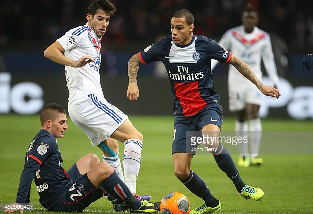 Gregory Van Der Wiel of PSG in action with Marco Verratti of PSG and Yoann Gourcuff of Lyon during the french Ligue 1 match between Paris...
