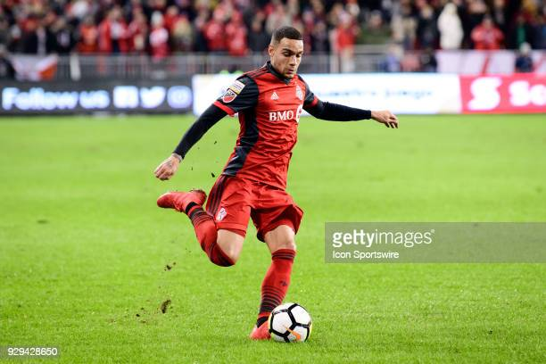 Gregory van der Wiel of Toronto FC crosses the ball during the CONCACAF Champions League Quarterfinal match between Toronto FC and Tigres UANL on...
