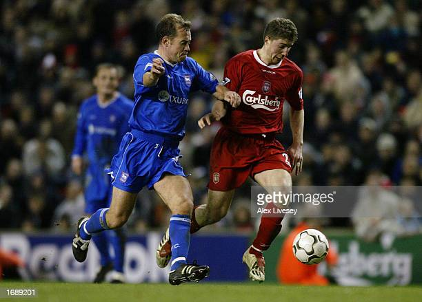 Gregory Vignal of Liverpool shields the ball from the challenge of Jamie Clapham of Ipswich Town during the Liverpool v Ipswich Town Worthington Cup...