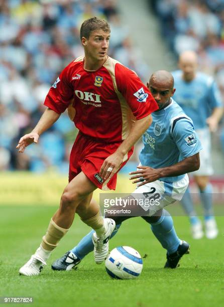 Gregory Vignal of Portsmouth and Trevor Sinclair of Manchester City in action during the Barclays Premiership match between Manchester City and...