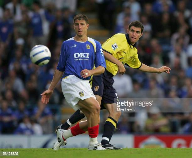 Gregory Vignal of Portsmouth battles with Aaron Hughes of Aston Villa during the Barclays Premiership match between Portsmouth and Aston Villa on...