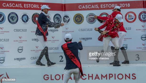 Gregory Wathelet and Darragh Kenny of winning team Paris Panthers spray champagne in jubilation with 2nd place team Scandinavian Vikings Christian...