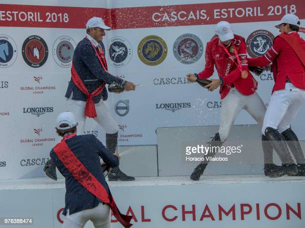 Gregory Wathelet and Darragh Kenny of winning team Paris Panthers spray champagne in jubilation at the end of 'CSI 5' GCL of Cascais Estoril Round 2...